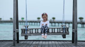 Adorable little girl having fun during beach vacation stock video footage