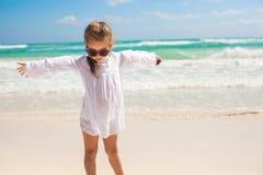 Adorable little girl having fun on an exotic white Stock Photos