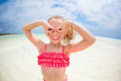 Adorable little girl having fun like as a superhero at beach Stock Images