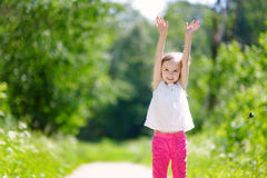 Adorable little girl having fun outdoors Royalty Free Stock Photo