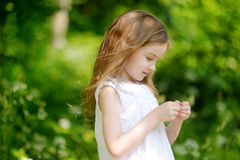 Adorable little girl having fun outdoors Stock Images