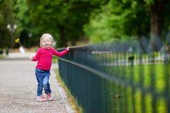 Adorable little girl having fun outdoors Stock Photography