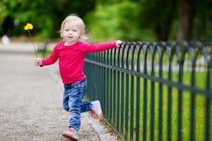 Adorable little girl having fun outdoors Stock Photos