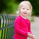 Adorable little girl having fun outdoors Stock Image