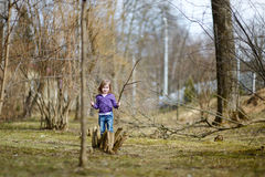 Adorable little girl having fun in a park Stock Images