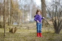 Adorable little girl having fun in a park Royalty Free Stock Photography