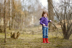 Adorable little girl having fun at spring Royalty Free Stock Photo