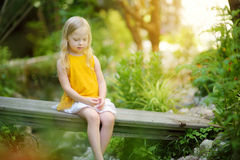 Adorable little girl having fun on sunny summer day in a park Stock Photography