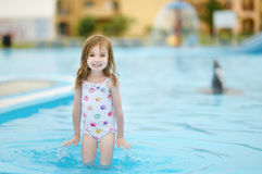 Adorable little girl having fun in a swimming pool Royalty Free Stock Photo