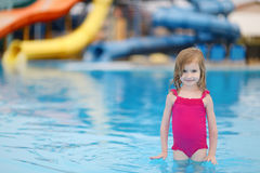 Adorable little girl having fun in a swimming pool Royalty Free Stock Image