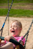 Adorable little girl having fun on a swing Royalty Free Stock Photo