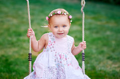 Adorable little girl having fun on a swing Royalty Free Stock Image