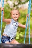 Adorable little girl having fun on a swing Royalty Free Stock Photos