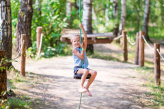 Adorable little girl having fun on a swing Royalty Free Stock Photography