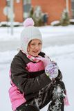 Adorable little girl having fun on winter day stock images