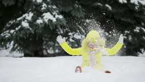 Adorable little girl having fun on winter day outdoors stock footage