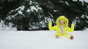 Adorable little girl having fun during winter vacation stock video footage