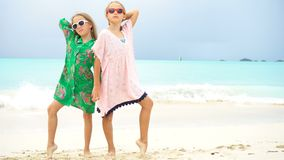 Adorable little girl having a lot of fun at tropical beach playing together. Little girls having fun at tropical beach playing together at shallow water stock video