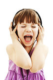 Adorable little girl with headphones Stock Photos