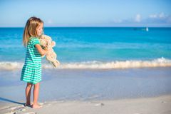 Adorable little girl with her bunny toy on Royalty Free Stock Photos