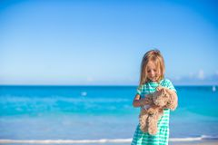 Adorable little girl with her bunny toy on Royalty Free Stock Photography