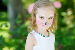 Adorable little girl with her face painted Royalty Free Stock Image