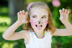 Adorable little girl with her face painted Royalty Free Stock Photo