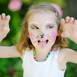 Adorable little girl with her face painted Royalty Free Stock Images