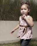 Adorable little girl with her hand on her chin Royalty Free Stock Photos