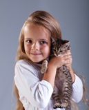 Adorable little girl and her kitten Stock Photos