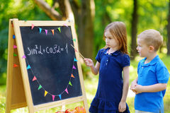 Adorable little girl and her little student Stock Images