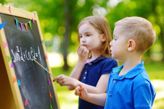 Adorable little girl and her little student Royalty Free Stock Image