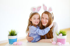 Adorable little girl and her mother wearing bunny ears on Easter Royalty Free Stock Images