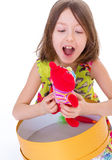 Adorable little girl with her red teddybear. Isolated on white background Stock Photography