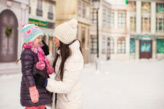 Adorable little girl and her young mother on a Royalty Free Stock Photography