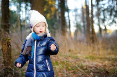Adorable little girl hiking in forest Stock Photo