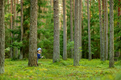 Adorable little girl hiking in the forest Royalty Free Stock Image