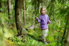 Adorable little girl hiking in the forest Royalty Free Stock Photo