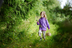 Adorable little girl hiking in the forest Stock Image