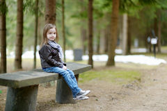 Adorable little girl hiking in the forest Stock Photos