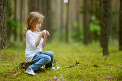 Adorable little girl hiking in the forest Stock Images