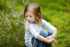 Adorable little girl hiking in the forest Royalty Free Stock Images
