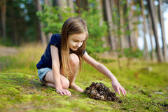 Adorable little girl hiking in the forest Stock Photo