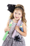 Adorable little girl holding big crayons Royalty Free Stock Images