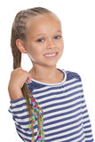 Adorable little girl holding dreadlocks Royalty Free Stock Images