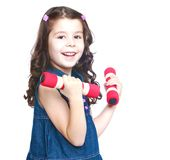 Adorable little girl holding a dumbbell, close-up Stock Photos