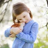 Adorable little girl holding easter bunny Royalty Free Stock Images