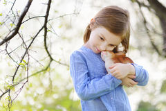 Adorable little girl holding easter bunny Stock Photos