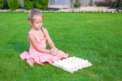Adorable little girl holding green Easter egg Royalty Free Stock Photography