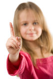 Adorable little girl holding index finger up. Isolated on white Royalty Free Stock Image